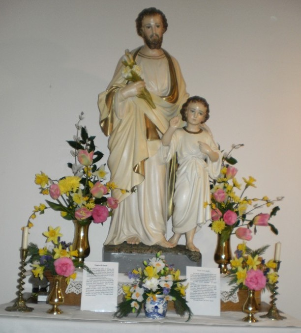 Statue of Saint Joseph decorated for his Feast Day